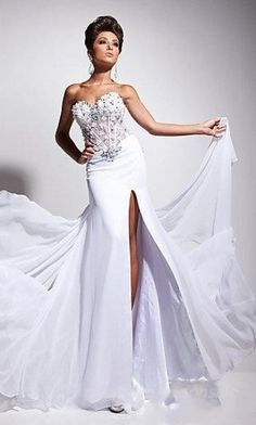 wedding dress ♥ I love the top jeweled part, but the leg split is a little too high for my taste.