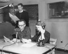WOUI broadcasting. Two men and a woman in the broadcasting room at WOUI; one man on microphone, woman on the phone and another reviews a file. WOUB, established by students in 1942, expanded to include FM station WOUI in 1949. The station, first located in Ewing Hall, was headquartered in an army surplus Quonset hut located on the College Green and later moved to Speech Building (now Kantner Hall).  :: Ohio University Archives