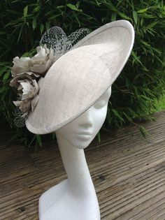Silver upturn hat with silk flowers and veiling by Susan Fage Millinery