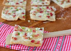 Flammkuchen - a thin crust german flat bread usually served with salad is a marvelous meal for lunch or dinner. Flammkuchen is just one of the german dishes you