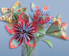 Origami paper flowers ~ Going to make some just for fun....So cute!