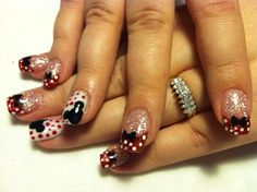 My amazing nail artist did me Minnie and Mickey Mouse nails ! love <3