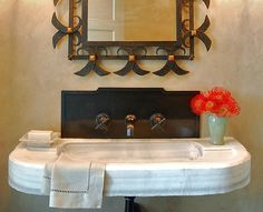 Spanish Home Architecture and Design    HER BATH The solid marble sink is 19th century Italian and the mirror is 1940's French.