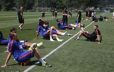 Players take a breather in the sweltering Seattle heat as they prepare for the game against Club America