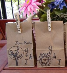 Small paper bags filled with the bird seed hearts with inititals