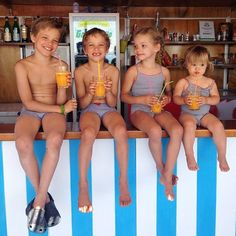 """""""A Positano tradition: a photo of the kids sitting on the bar at the beach. We've been taking this photo since it was just little Easton sitting there. (The locals joke that we come back every year with another baby!)"""" - - - what a super cute family tradition!"""