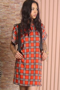 Tee dress by Evil Twin full of attitude, made from patterned jersey. A cool take on the plaid trend, featuring roll short sleeves, round neckline and mini length.