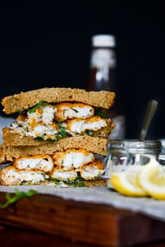 Homemade fish finger sandwich with tartar sauce and rocket