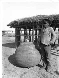 Morris Jones, a Pima Indian man, and storage basket with little girl standing inside, :: California Historical Society Collection, Native American Legends, Native American Photos, Native American Tribes, Native Americans, Indian Man, Native Indian, Native Art, Pima Indians, University Of Southern California
