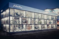 Electra BikeHub by Andrey Ukolov & Ekaterina Osipova, Saint Petersburg Russia showroom store design bicycle Visual Merchandising, Retail Facade, Bicycle Store, Container Shop, Bicycle Brands, St Petersburg Russia, Showroom Design, Interior Design, Bicycle Maintenance