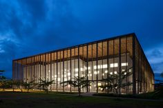 positioned at the center of the university of guyana campus, rh+ architecture has developed a library building entirely enclosed within a timber lattice.