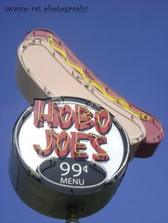 hot dog sign  Write a character analysis of the owner opening Hobo Joes on a hot Saturday morning.  Write in descriptive, active voice, using chronologicl order