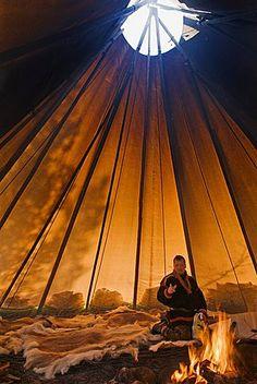 Sami reindeer herder inside his lavvu tent, Giron Siida homestead, Kiruna… Tenda Camping, Native American Teepee, Camping Sauvage, Teepee Tent, Teepees, Outdoor Movie Nights, Lappland, Outdoor Life, Bushcraft