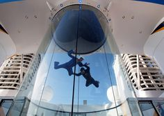 People use the skydiving simulator on board the cruise ship Quantum of the Seas.