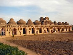 Hampi Elephant Stables / Vijayanagara complex in Karnataka, India. These 11 domed chambers were once built to house the royal elephants. Awesome want to visit! Hampi India, Karnataka, Places To Travel, Places To See, Holiday Destinations In India, Travel Destinations, Indian Architecture, Historical Architecture, Ancient Architecture