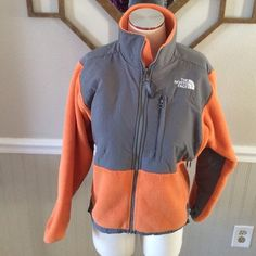 """North Face Denali Great orange and gray color combination!  In good preowned condition!  Measures 23"""" long and 20"""" armpit to armpit North Face Jackets & Coats"""