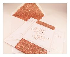 Layered pocket invitations with rose gold belly band Deannamic Designs