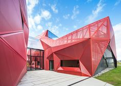 Espace Culturel de La Hague by Périphériques,  Beaumont-Hague, France. Formed entirely of triangular facets, this three-dimensional surface is made from colourfully anodised steel beams and mesh.