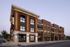 A traditional mixed use development that uses brick and stucco