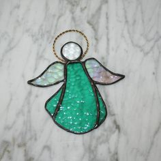 Stained glass angel suncatcher, sea green, jewel head, brass wire halo for window decor or wall hanging, women or girls gift by Glasspainter1 via Etsy.