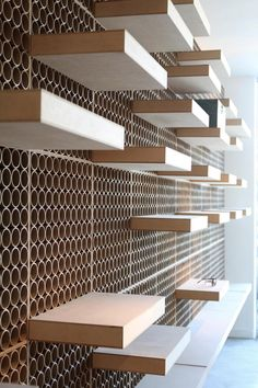 Floating Shelves  DR. York optical store by DCPParquitectos, Los Angeles store design