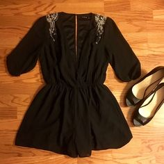 Adorable beaded black romper Super light fun and flirty black romper. Tag says size medium but will also fit a size small. Beaded crystals hang down from both shoulders Dresses