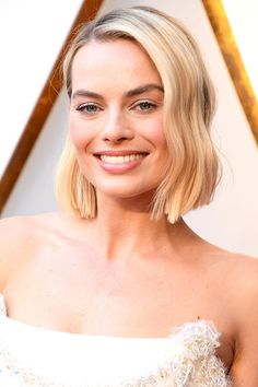 2018 Oscars - Margot Robbie  Margot hit the Oscars red carpet with a brand new bob haircut. Makeup artist Pati Dubroff used Chanel Rouge Coco 432 Cecile and Poudre Lumiere 10 in Ivory Gold for her pretty pale pink look, with subtle silver eyes complementing her divine Chanel gown.