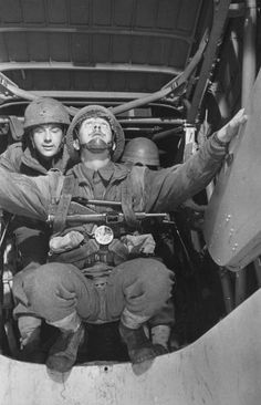 18th March 1944: A soldier watches the signal light above his head as he waits to jump from the plane during parachute drill. Original Publication: Picture Post - 1599 - Paratroops - pub. 1944 (Photo by Haywood Magee/Picture Post/Getty Images)