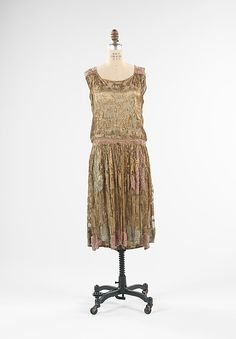 Evening dress House of Paquin  Designer: Madeleine Wallis (French)  Date: spring/summer 1927 Medium: silk, metal Credit Line: Brooklyn Museum Costume Collection at The Metropolitan Museum of Art, Gift of the Brooklyn Museum, 2009; Gift of Mrs. Allen Lehman, 1940 Jeanne Paquin, 1920s Outfits, Vintage Outfits, Vintage Fashion, Designer Evening Dresses, French Fashion Designers, Costume Collection, 1920s Dress, Costume Institute
