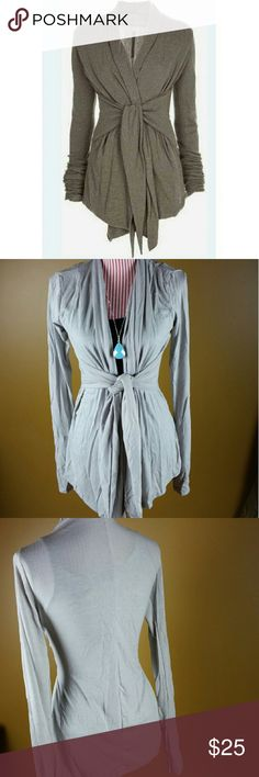 Gray Tie Waist Cardigan Chic cardigan in a pretty gray. Ties at the waist. Cotton material. NOTE: Tag displays a size larger than the actual fit. Please see measurements below.   XSmall - Bust: 31.50, Length: 27.56  Small - Bust: 33.07, Length: 27.95  Medium - Bust: 34.65, Length: 28.35 Sweaters Cardigans