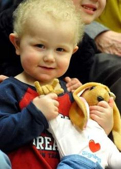 Tyler Hoiland, age 2, holds a sign language doll teaching aid donated to the Montana School of the Deaf and the Blind on Tuesday morning by a California company that makes the dolls. The donation came with help from the Great Falls Lions Club, which requested the doll on behalf of the school.