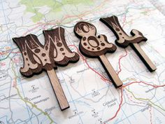 Wooden Initial Wedding Cake Topper on Etsy, £12.00