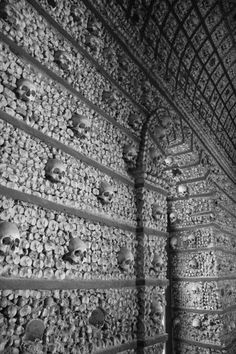 The Sedlec Ossuary is a small gothic church in Kutna Hora, Czech Republic. It is adorned with the bones of some 40,000 people, most of them victims of the black death.