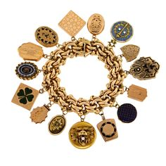 FANTASY CHARM BRACELET Featuring Period Lockets  This exciting gold charm bracelet features fifteen lockets. Dating from the 1880s to the 1920s, half are enamels, (one by Marcus and Co.) the rest are uniquely engraved or figured. All are outstanding quality. The bracelet is 14k, Austrian, and quite heavy.