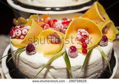 Beautiful ice cream cake decorated with fruit-shaped flowers - stock photo