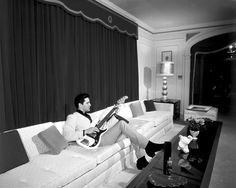 March 7th, 1965 - Elvis Presley chillin' on electric bass inside Graceland. (via The Selvedge Yard) ... (My grandma's sister worked in Memphis, and recovered THIS couch for Elvis! :-D )