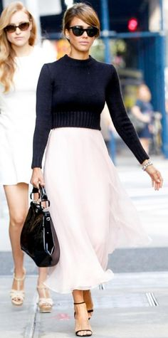 Look of the Day › September 13, 2013 WHAT SHE WORE Alba headed to the Ralph Lauren spring/summer 2014 show in pretty pale pink midi skirt, a black long-sleeve knit sweater and black accessories, all by the designer. Jewelry wise, she wore Jamie Wolf earrings and an EF Collection ring.