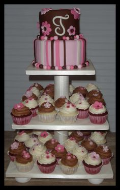 Pink and brown cupcakes on home-made display. By Susan's Cake Studio