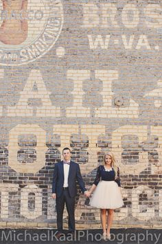 Urban downtown engagement shoot. Complete with a suit, bowtie, and tulle skirt.