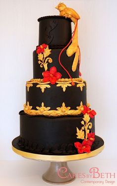 Golden hand moulded gumpaste Bird of Paradise perched on top of a completely chocolate wedding cake (I covered it with SatinIce dark Belgian chocolate fondant, which was amazing to work with!). Exotic gold and chilli red details.