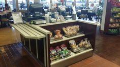 Double sided cashier stand designed with corian tray slides with stainless steel runners. Increase impulse sales with a build in double shelf snack rack.