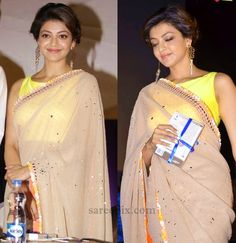 """Actress Kajal agarwal in nude mirror work saree, designed by Neeta lulla, at tamil movie """"Paayum puli"""" audio launch. Yellow boat neck blouse and updo hairs"""
