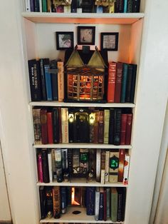 Because everyone needs a bit of whimsy on their shelf Bookshelves Ideas bit Shelf whimsy Book Crafts, Diy And Crafts, Idee Diy, Diy Interior, Miniature Houses, Book Nooks, Altered Books, Bookshelves, Decoration
