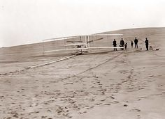 The Wright Brothers preparing for their first flight in Kill Devil Hills, NC.