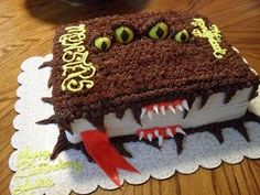 "Brandi's Sweets: The ""Monster Book"" from Harry Potter - just picture  of Cake - no tutorial - Looks like the ribbon could be fun fruit roll ups."