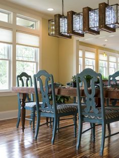 Nestled within easy reach of the kitchen, the dining space blends salvaged, hand-crafted design with eclectic style.