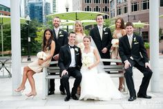 Love the use of the bench and bright green umbrellas in the background...not your boring wedding shot