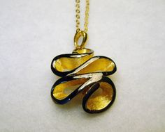 Luxurious postmodern pendant plus chain, goldplated sterling silver, black rhodium finishing by FavelaJewelry on Etsy