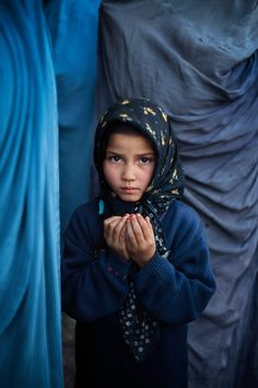 Girl praying at a mosque, Kabul, Afghanistan