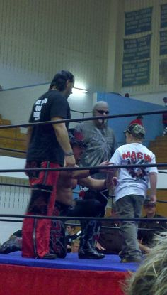 Matt Hardy, Buff The Stuff Bagwell, and Scott Steiner about to take a pic with a fan